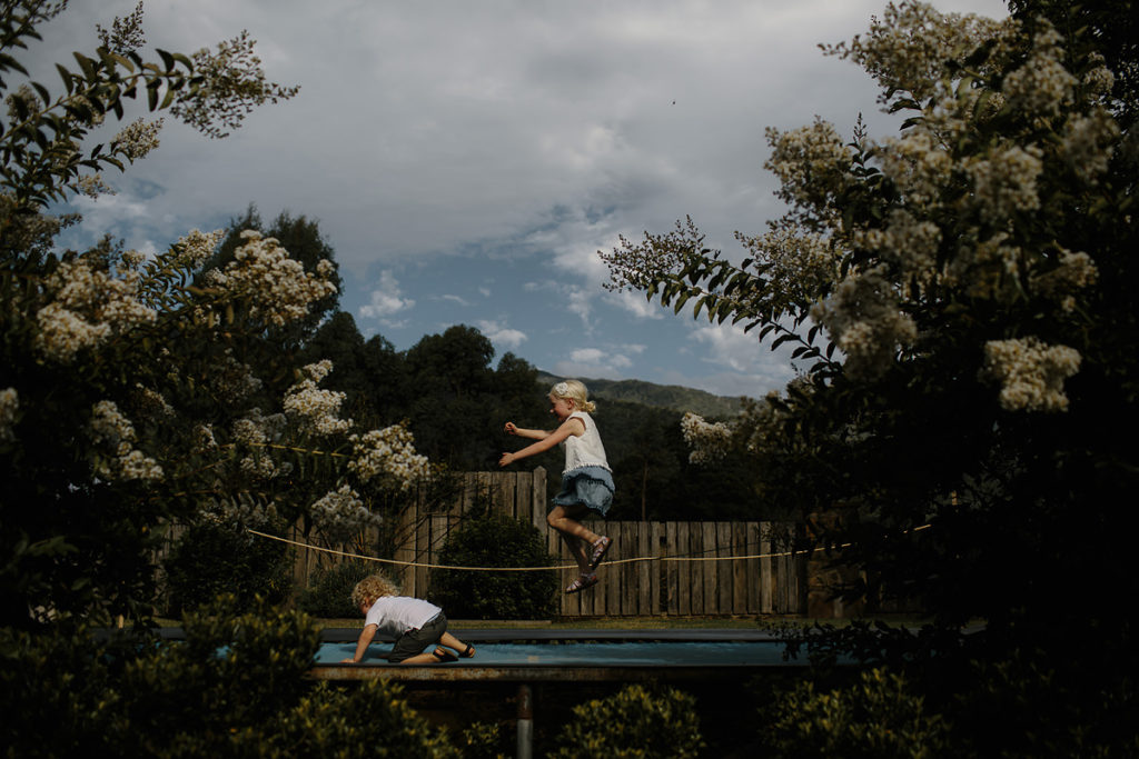 Wes anderson style wedding photography - kids on trampoline