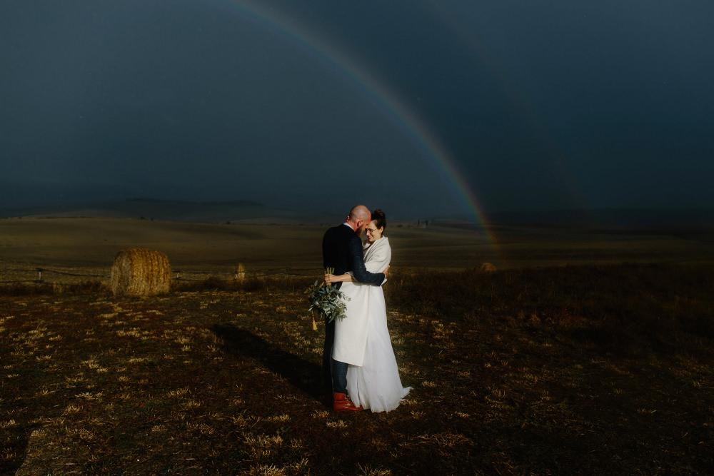 Rainbow sun shower wedding portrait