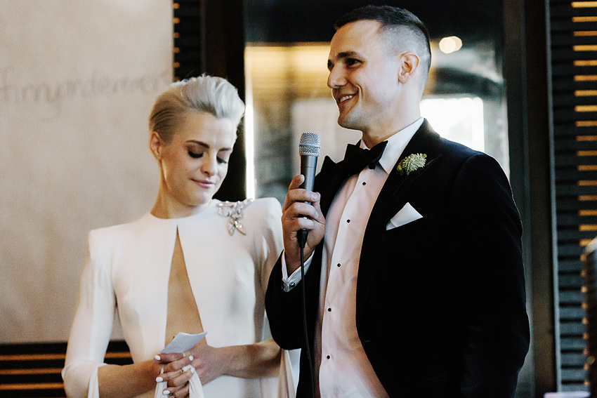 a photo of a wedding couples welcome speech at their wedding reception