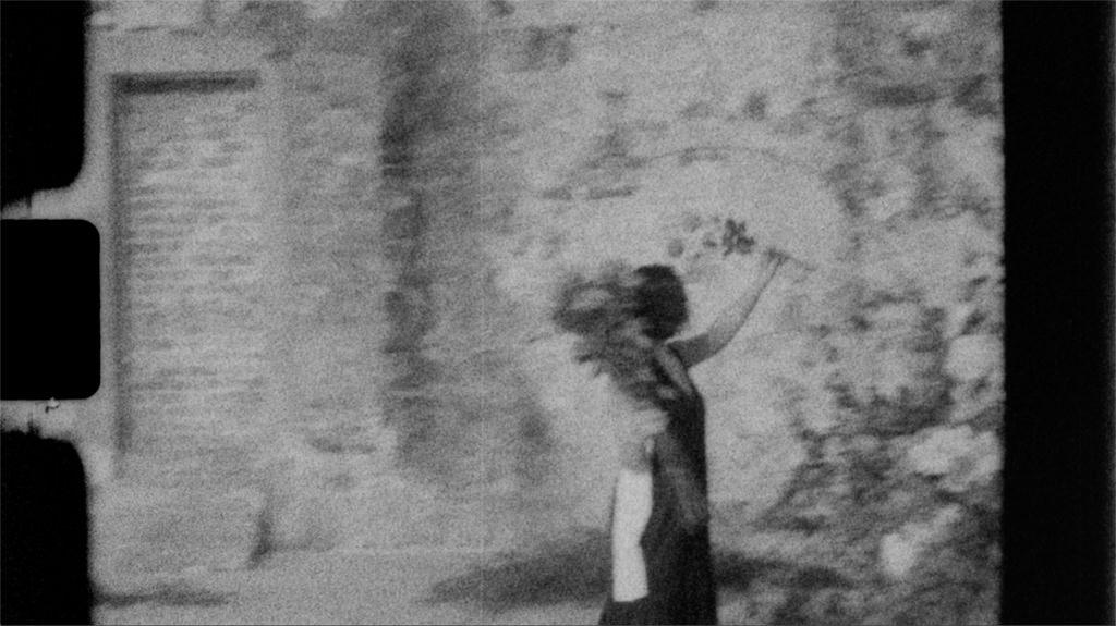 a super 8 wedding film still of Gina (Georgie Boy flowers)